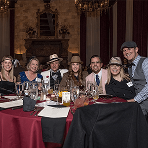 Kansas City Murder Mystery party guests at the table