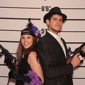 Kansas City Murder Mystery party guests pose for mugshots